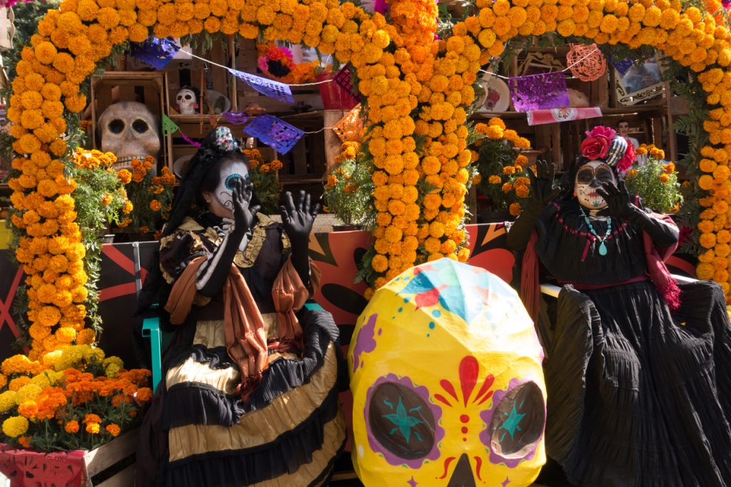 Mexico City, Mexico - October 29, 2016: Old Women on Marigold Flower Parade Floats During the Day of the Dead